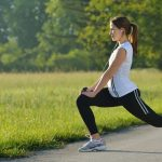 woman stretching and getting ready to exercise outside